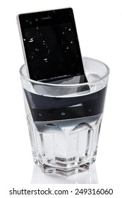 Smartphone in glass with water on white background