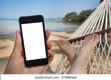 smartphone in the hand in beach hammock
