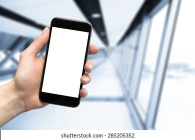 smartphone in hand and blurred background