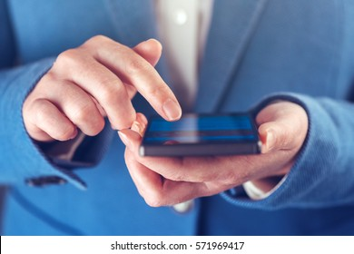 Smartphone in hands of businesswoman, modern electronics device as business organizer and communicator