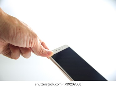 The smartphone in the hands of a man