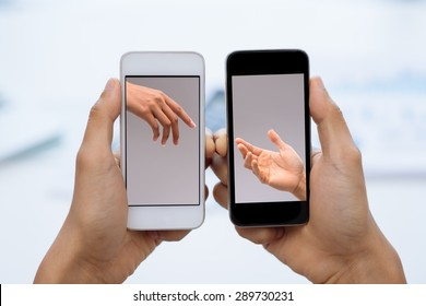 Smartphone with images of female and male hands reaching to each other: communication concept