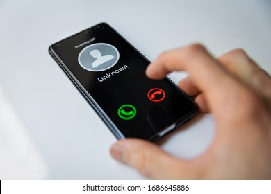 smartphone with incoming call from unknown person