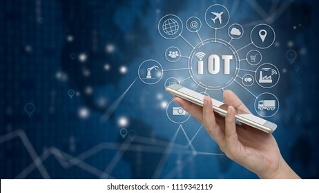 Smartphone with Internet of things (IOT) word and objects icon connecting together, Internet networking concept, Connect global wireless devices with each other.