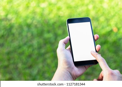Smartphone in man's hands. View from above.Smartphone with blank screen for your info.