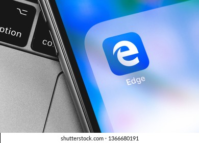 smartphone with Microsoft Edge icon app on the screen. Microsoft Edge is a Microsoft browser designed to replace Internet Explorer. Moscow, Russia - April 9, 2019