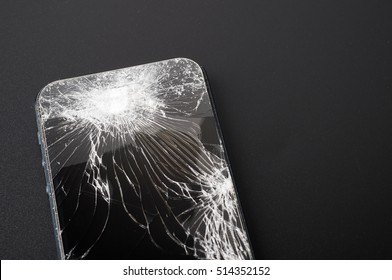Smartphone mobile with a broken screen. Background black