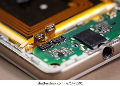 Smartphone motherboard connectors in macro.