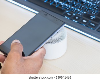 Smartphone and NFC  speaker, Using NFC application on smartphone to connect with wireless speaker.NFC (Near Field Communication) ,selective focus.