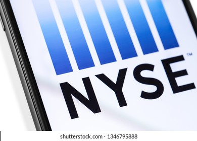 smartphone with NYSE logo on the screen. NYSE (New York Stock Exchange) is an American stock exchange. Moscow, Russia - March 17, 2019