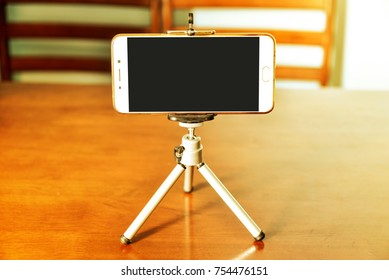 Smartphone on a tripod in living room