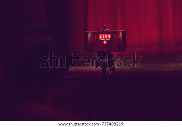 smartphone on tripod wait for video live streaming in theater, technology social concept
