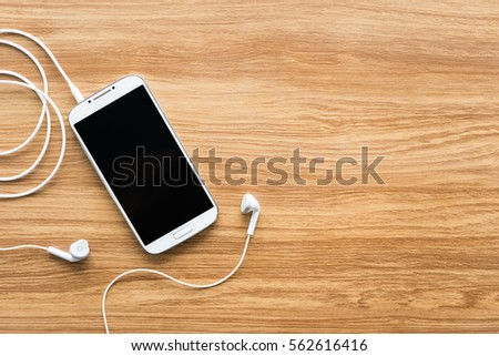 Smartphone On Wooden Background Listen Music Stock Photo