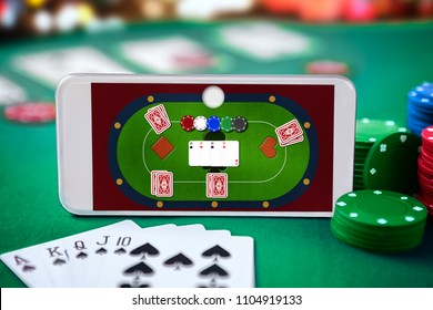 Smartphone with online poker table. Online casino. Gambling games.