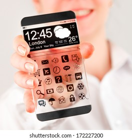 Smartphone (phablet) with a transparent display in human hands. Concept actual future innovative ideas and best technologies humanity.