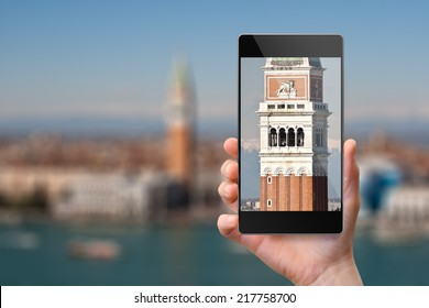 Smartphone photographing Campanile in Venice, Italy