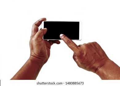 The smartphone is positioned horizontally on the left-hand side of a man with a tan skin doing a white background gesture. The smartphone screen is black. Hands of the elderly To reach the elderly