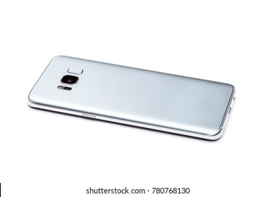 Smartphone is the rear side view, view of the back of the phone with a camera, flash and a fingerprint scanner in a glass case, isolated on a white background.