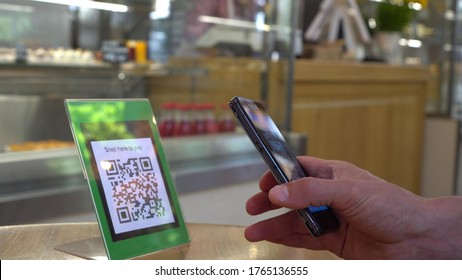Smartphone scanning the recipient's QR code. Mobile banking. Customers can pay through QR code, bank card, bank account or e-wallet by using payment gate