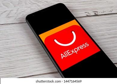 Smartphone showing AliExpress app logo on an a screen. Manhattan, New York, USA - July 4, 2019.