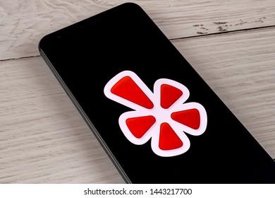 Smartphone showing Yelp app logo, Manhattan, New York, USA - July 2, 2019.