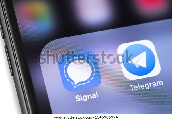 smartphone with Signal and Telegram icons app on the screen. Social media, messengers. Moscow, Russia - March 17, 2019