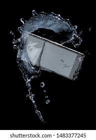 Smartphone with splashing of water or explosion flying in the air isolated on black background