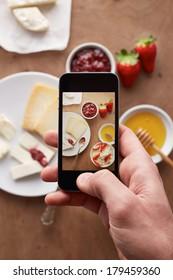 Smartphone taking picture of breakfast overlook shot