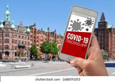 Smartphone mit Tracking-App und Covid-19 Corona-Virus Coronavirus