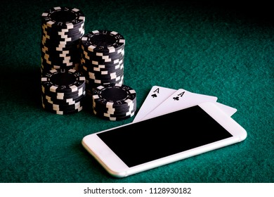 Smartphone with two ACEs in poker and casino chips