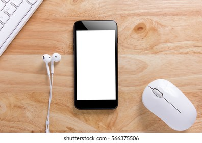 Smartphone with White Screen on Wooden Table Workspace, Mockup of Modern Black Color Smartphone and ear headphone,White Keyboard and Mouse