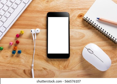 Smartphone with White Screen on Wooden Table Workspace, Mockup of Modern Black Color Smartphone,White Keyboard,Mouse and Ear headphone