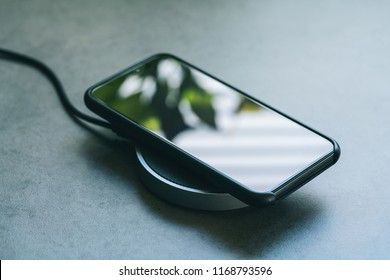 smartphone wireless charging on induction charger. Wireless charger