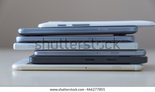 Smartphones piled up on the table