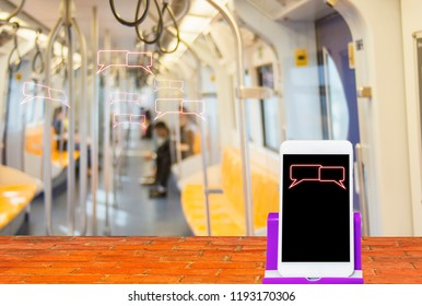 Smartphones in place on brick floor, on message symbol screen, in sky train cabin, blurred with communication concept, covering all space and comfort of modern society.