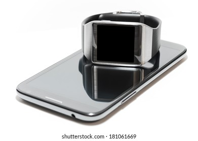 Smartwatch with black screen over a phablet as the concept of portable technology