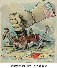 SMASHED! American political cartoon prematurely declaring victory over Philippine insurgency. March 8, 1899. A giant American gloved fist holds down Filipino leader, Emilio Aguinaldo. In fact, the Phi
