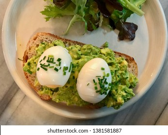 Smashed Avocado Tartine Paste with Boiled Eggs with Bread Slice for Breakfast