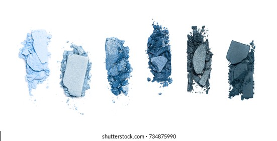 A smashed, blue toned eyeshadow make up palette isolated on a white background