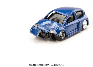 Smashed up children's toy car isolated on white background