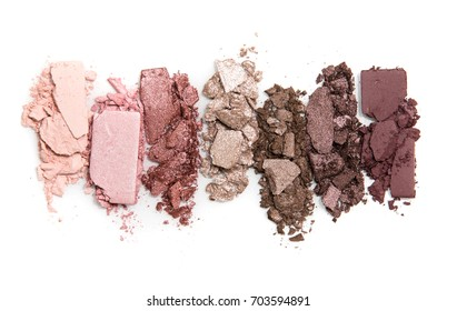 A smashed, neutral toned eyeshadow make up palette isolated on a white background