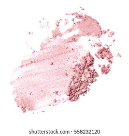 smashed pink gold brush stroke of eyeshadow and blush isolated on white background