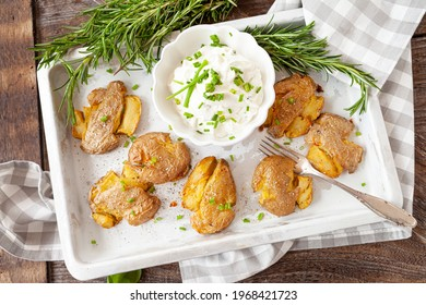 Smashed potatoes, crisp baked potatoes with fresh rosemary