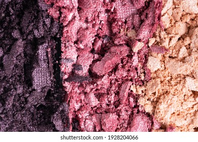 Smashed set of multicolor eyeshadow. Close-up of a makeup product.