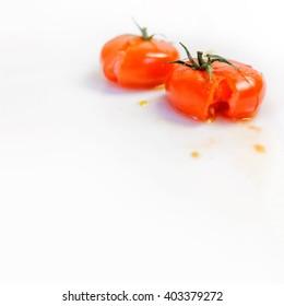 Smashed tomatoes on a white table aka fresh ketchup