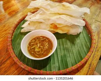 Smashing rice paper or Banh Dap, traditional Vietnamese food of Hoi An