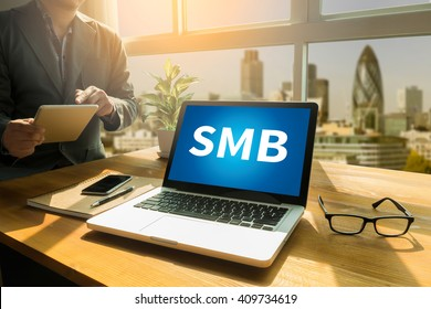 SMB - Small and Medium-Sized Business Thoughtful male person looking to the digital tablet screen, laptop screen,Silhouette and filter sun