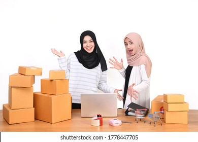 Sme business concept. women people are packing their packages.Delivery business Small and Medium Enterprise (SMEs). Beautiful women are delighted in success.