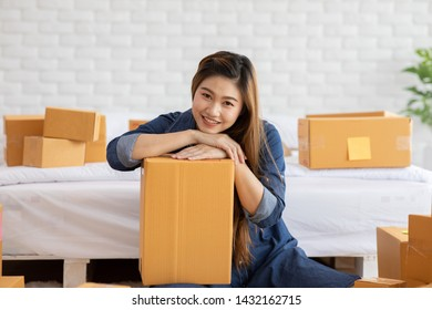 SME entrepreneur of Young Asian women working with laptop for Online shopping at home,Cheerful and Happy with box for packaging in home,Own Business Start up for Business Online and Online shopping