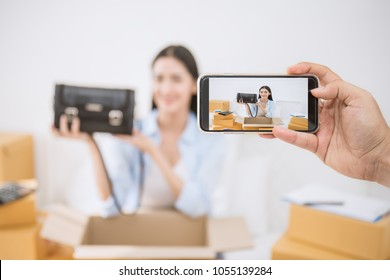 SME freelance woman talk camera live record video social network, Young Asian small business owner using smartphone, online marketing delivery, SME e-commerce telemarketing influencer vlog concept